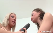 Lesbian angels in devilish strapon action