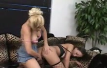 Cute lesbians using strap on for fucking
